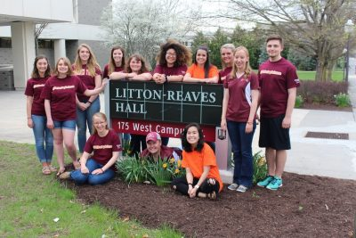 The 13 2017-2018 DASC ambassadors by the Litton-Reaves Hall sign in Hokie colors.