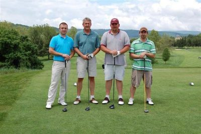 DairyCheq US. Pictured left to right: Robert Hoyt, Dave Luzader, J.J. Kinsey, Chuck Hazelwood.