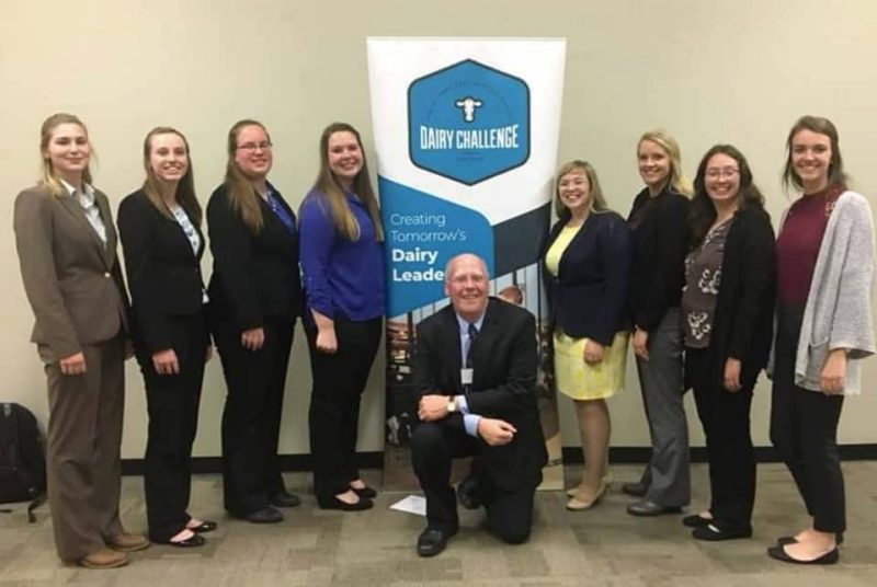 The Dairy Challenge Team (on left side- L-R) Kate Ciaston, Katelyn Allen, Sandra Krone, Sarah Baynard; middle - Coach Dr. Alex White; Dairy Challenge Academy students (on right side L-R) Sarah Thomas, Kennedy Crothers, Becky Wilkins, Ellie Grossnickle