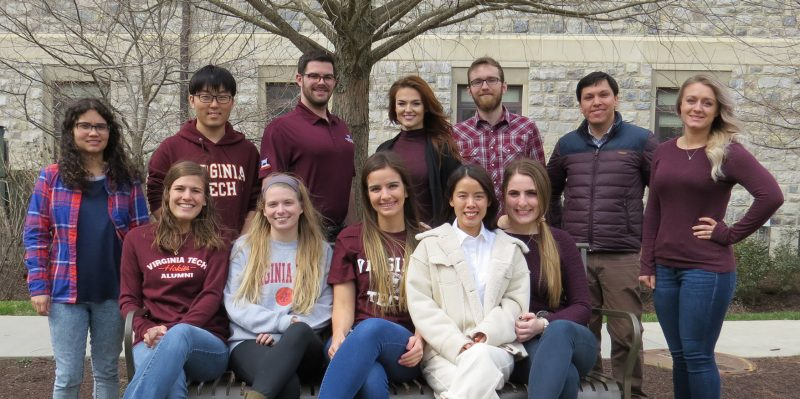 Spring 2019 graduate students in front of Hokie stone.